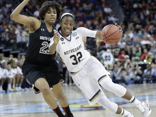 FILE - In this April 5, 2015, file photo, Notre Dame guard Jewell Loyd (32) moves by South Carolina guard Tina Roy (23) during the first half of the NCAA Women's Final Four tournament college basketball semifinal game in Tampa, Fla. Seattle coach Jenny Boucek spent the last few months working on a draft board since the Storm have the first and third picks in the WNBA draft Thursday, April 16, 2015. All that preparation got scrapped last week when Notre Dame junior Jewell Loyd and Minnesota red-shirt sophomore Amanda Zahui B. decided to turn pro.(AP Photo/John Raoux, File)