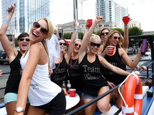 Bride-to-be Whitney Childress of Alabama celebrates with friends during her bachelorette party in Nashville Party Barge on Saturday  July 18, 2015.