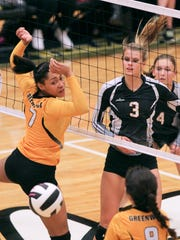 T.L. Hanna's Mary Chamblee Craft kills a ball by Greenwood's Karson Burton-Reeder during the third set at T.L. Hanna High School in Anderson. T.L. Hanna won 3-0.