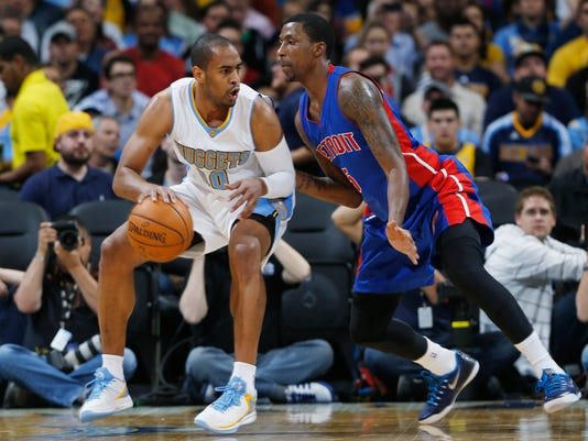 Denver Nuggets guard Arron Afflalo, left, works the ball inside for shot as Detroit Pistons guard Kentavious Caldwell-Pope covers in the first quarter of an NBA basketball game in Denver on Wednesday, Oct. 29, 2014. (AP Photo/David Zalubowski)