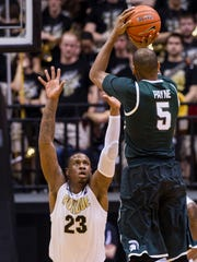 Michigan State?s Adreian Payne (5) puts up a shot over the defense of Purdue?s Jay Simpson (23) in the second half of an NCAA college basketball game, Thursday, Feb. 20, 2014, in West Lafayette, Ind. Michigan State defeated Purdue 79-94. (AP Photo/Doug McSchooler)