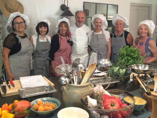 Cooking class Lucy Himstedt, Peggy Chastain, Nan Byrd, Chef Jean-Marc Villard, Karleen Wink, Pat Bateman and Jo Keating pose for a souvenir photo during their cooking class while visiting the village of Maubec, France. These good friends were on a 10-day vacation to Paris and St. Remy, France.