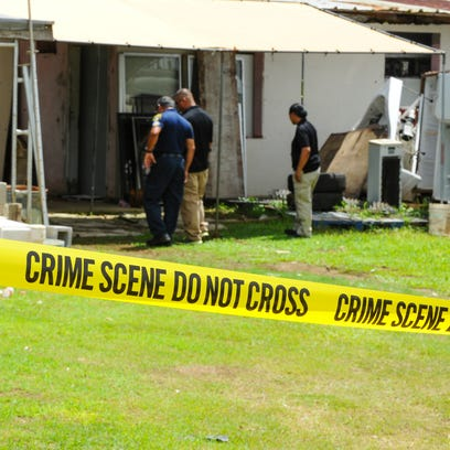A diesel generator illuminates a crime scene at the Intersection of Route 10 and Jolene Loen Guerrero Road in Barrigada, just south of the Tri-intersection, on Oct. 8. The Guam Police Department posted officers to secure the perimeter until the investigation of a possible death could continue in the morning.
