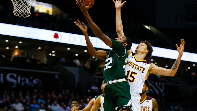 CSU's J.D. Paige slips underneath the defense of Missouri State's Jarrid Rhodes to get off a shot during Tuesday night's game at Hammons Arena in Springfield, Mo.