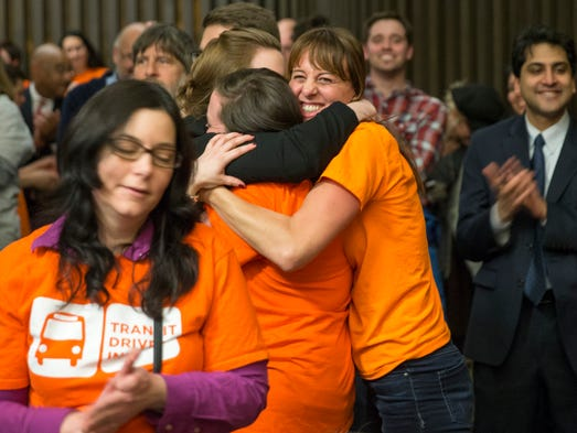 Hugs and cheers upon the passing of a transit tax designed