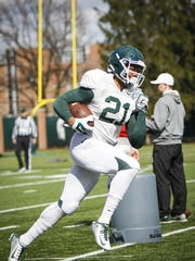 MSU freshman receiver Cam Chambers runs the ball at practice Tuesday in East Lansing.