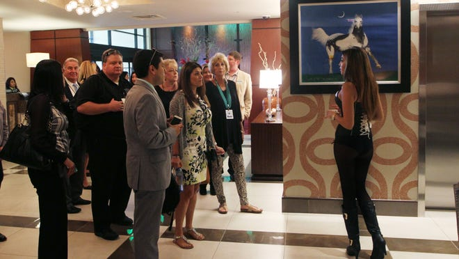 Seminole Casino Hotel ambassador Gisselle Crespo, right, prepares to take visitors to the Seminole Casino Hotel on a tour following a ribbon cutting ceremony on Thursday.
