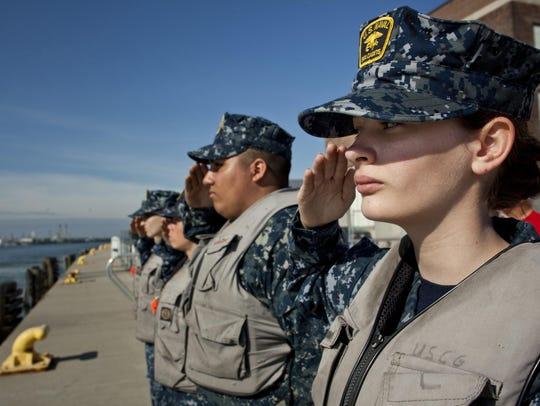 U.S. Naval Sea Cadet Emily Hendricks, 14, salutes retired