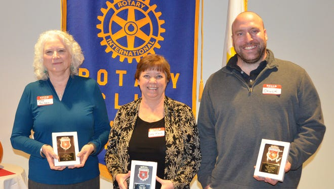 Jody Scriber, Sally Klein and Chuck Jackson display their awards after being recognized by the Rotary Club of Ithaca for commendable efforts in the workplace.