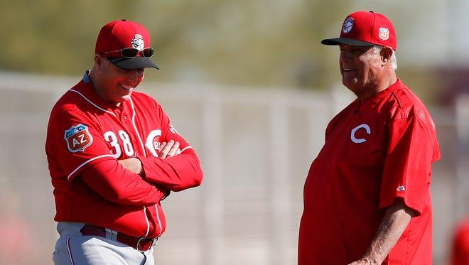 Cincinnati Reds manager Bryan Price (38), left, and senior advisor to baseball operations Lou Piniella talk at Cincinnati Reds spring training, Thursday, Feb. 25, 2016, in Goodyear, Arizona.