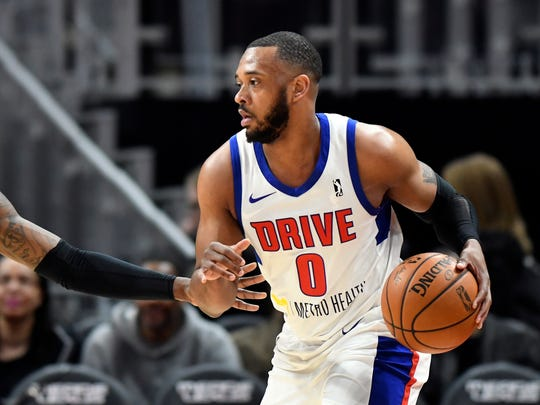 Grand Rapids Drive forward Zeke Upshaw dribbles during