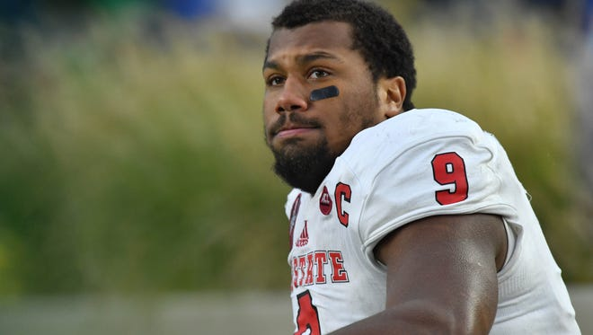 North Carolina State Wolfpack defensive end Bradley Chubb (9) watches from the bench in the third quarter against the Notre Dame Fighting Irish at Notre Dame Stadium.