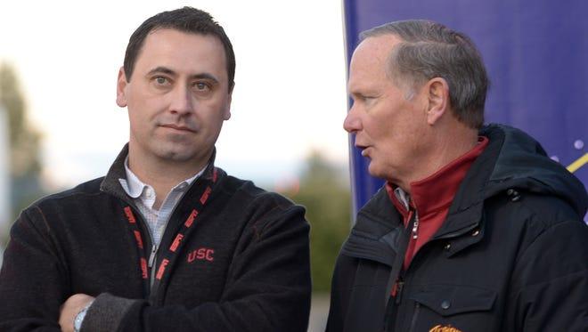 USC coach Steve Sarkisian (left) and athletic director Pat Haden talk.