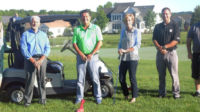Preparing for the SRMC Golf Classic at the Links Golf Course at Firestone Farms are, from leftm SRMC Foundation Director Amy Reed; SRMC Foundation Board Members John Biastro, George Morris III and Lynn Scullion; Links Golf Pro Michael Ferranti; and Links Golf Course Manager, Delmar Campbell.