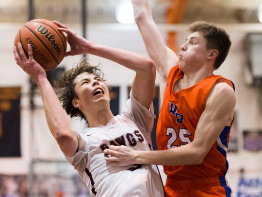 Bearden's Drew Pember puts up a shot during a District 4-AAA semifinals game against William Blount last season.