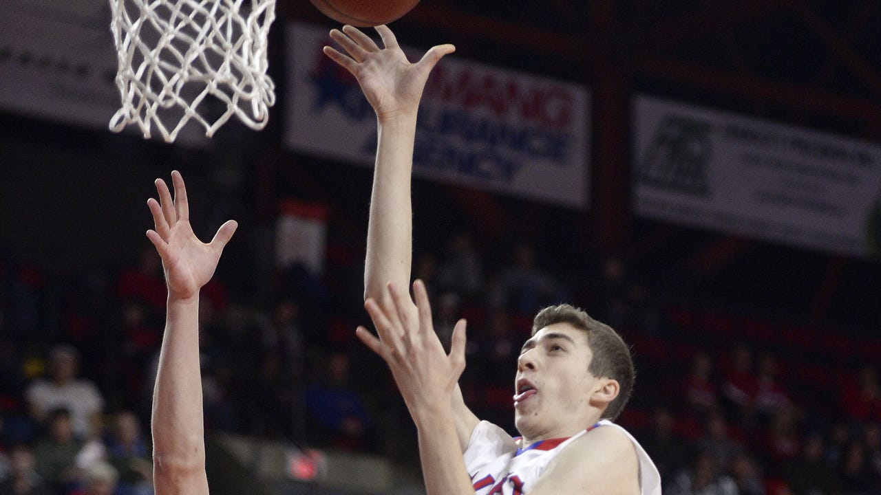 Fairport defeated Liverpool 69-52 in the Class AA basketball state semifinals on March 18, 2017.
