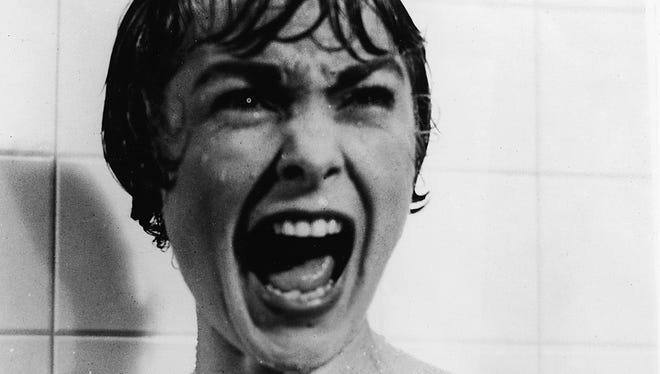 Janet Leigh screams in the shower in the famous scene from the film 'Psycho' directed by Alfred Hitchcock, 1960.