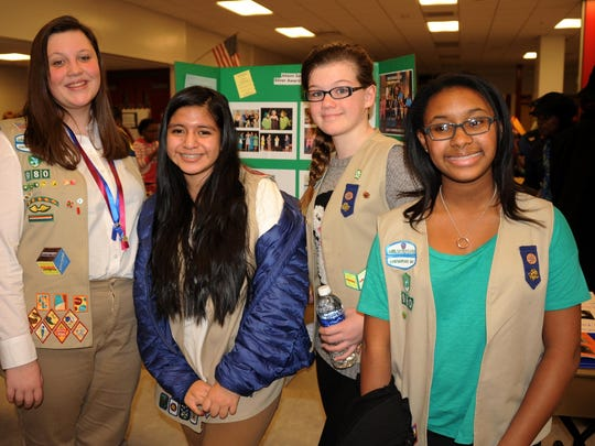 Members of Girl Scout Troop 980, from left, Alison Sahler, Hannah Burchard, Emily Robinson and Mia Fisher pose in front of a storyboard describing Sahler's Silver Award project. Sahler is now a sophomore and Burchard, Robinson and Fisher are freshmen, all at James M. Bennett High School.