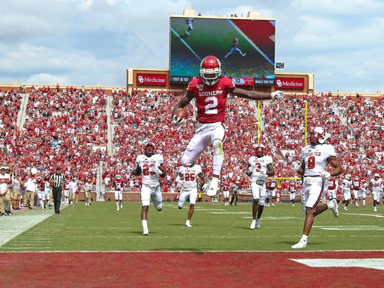 Sep 28, 2019; Norman, OK, USA;  Oklahoma Sooners wide receiver CeeDee Lamb (2) leaps for a touchdown past Texas Tech Red Raiders defensive back Zech McPhearson (8) during the third quarter at Gaylord Family - Oklahoma Memorial Stadium. Mandatory Credit: Kevin Jairaj-USA TODAY Sports