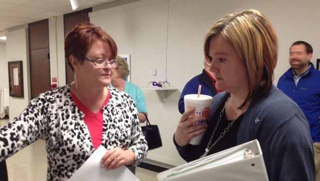 Karole Passmore, left, talks to Amanda Wilson, director of JACY House, during networking time before a 2014 Indiana University East Spring Leadership Forum.