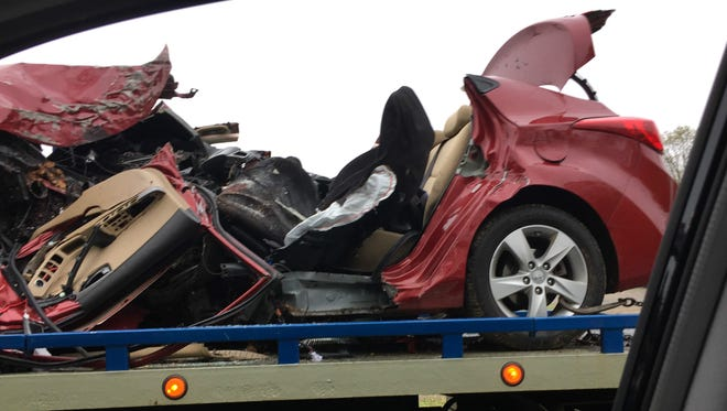 The car crushed in a fatal accident on the Palisades Interstate Parkway in Haverstraw is towed on Willow Grove Road, May 2, 2016. The woman driving the car was killed.