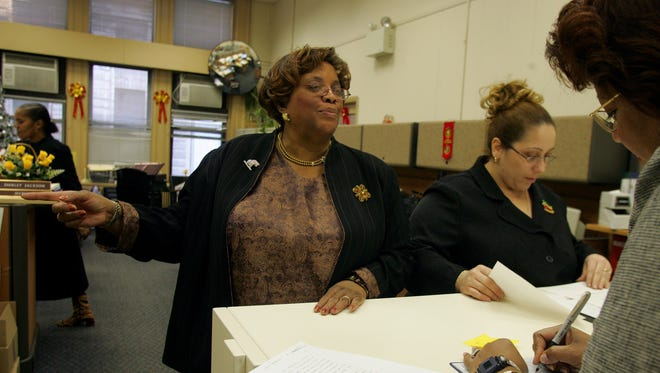 Jane Williams-Warren, center, in 2004, during her time as city clerk of Paterson.