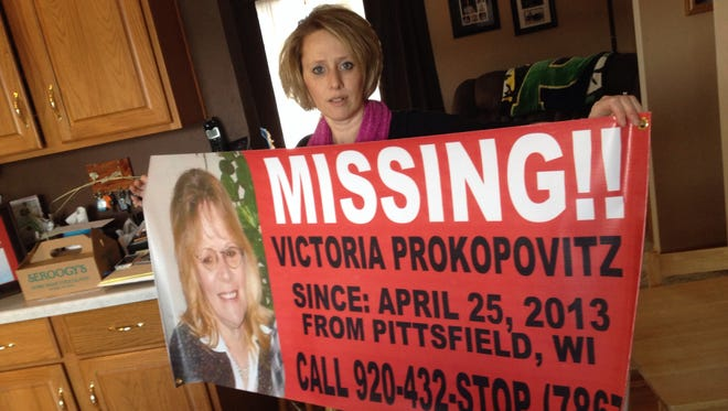 Marsha Loritz holds a banner urging information to be reported about her missing mother, Victoria Prokopovitz, a Pittsfield woman who disappeared in 2013.