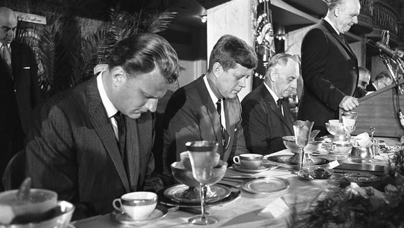 President John F. Kennedy and others at the head table