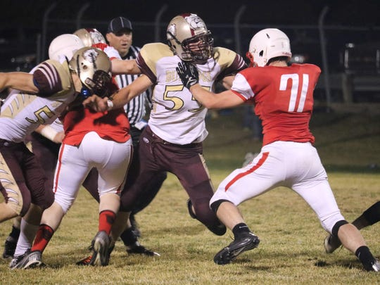 Benjamin Roeder, 55, pressures the Conrad quarterback last fall. He played both offense and defense and was second team for both in the Northern 1B his senior year.