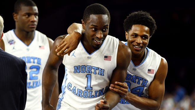 North Carolina Tar Heels forward Theo Pinson (1) and North Carolina Tar Heels guard Kenny Williams (24) react after the game against the Syracuse Orange in the 2016 NCAA Men's Division I Championship semi-final game at NRG Stadium.