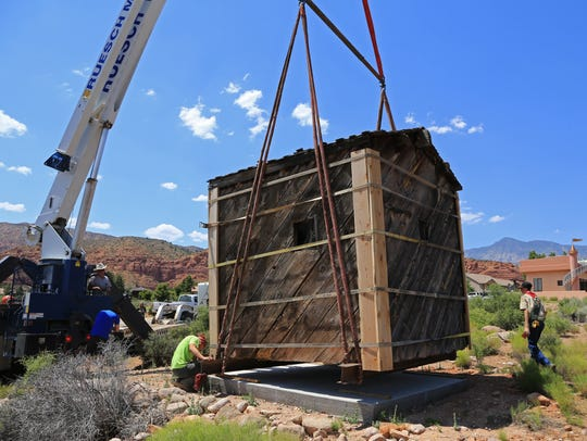 The old Silver Reef jail is unloaded Tuesday in Silver