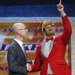 D'Angelo Russell, right, gestures upward as he is greeted by NBA Commissioner Adam Silver after the Los Angeles Lakers selected Russell with the second pick in the NBA Draft Thursday in New York.