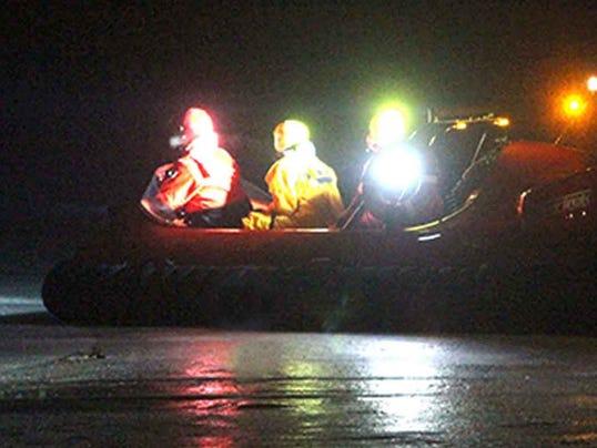 ATV goes through the ice on Pewaukee Lake