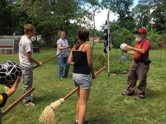 On Sunday, Aug. 13, 2017 at Mia and Chris Pugh's home in Churchville, players from the four houses of Hogwarts practice quidditch in preparation for Staunton, Virginia's Queen City Mischief & Magic on Sept. 22-24. Game 1 will open the Hogwarts Homecoming Quidditch Games when houses Hufflepuff and Ravenclaw enter the stadium in downtown Staunton 6 p.m. Friday, Sept. 22. Game 2 will follow at 7 p.m. with Gryffindor vs. Slytherin. Winners of games 1 and 2 duke it out at 8 p.m. to determine who will be victorious. Pictured left to right: Cody Madison – Slytherin; Mia Pugh - Helga Hufflepuff; Karmen Warren – Ravenclaw; Chris Pugh – Godric Gryffindor. The Pughs, of Medieval Fantasies Company, organize the Hogwarts Homecoming Quidditch Games and return as The Founders of Hogwarts. During the games, Chris, Godric Gryffindor, will act as head referee and Mia, Helga Hufflepuff, will be score keeper. Founders Rowena Ravenclaw and Salazar Slytherin, Dianna and Dan Pittman, will also assist in the games.
