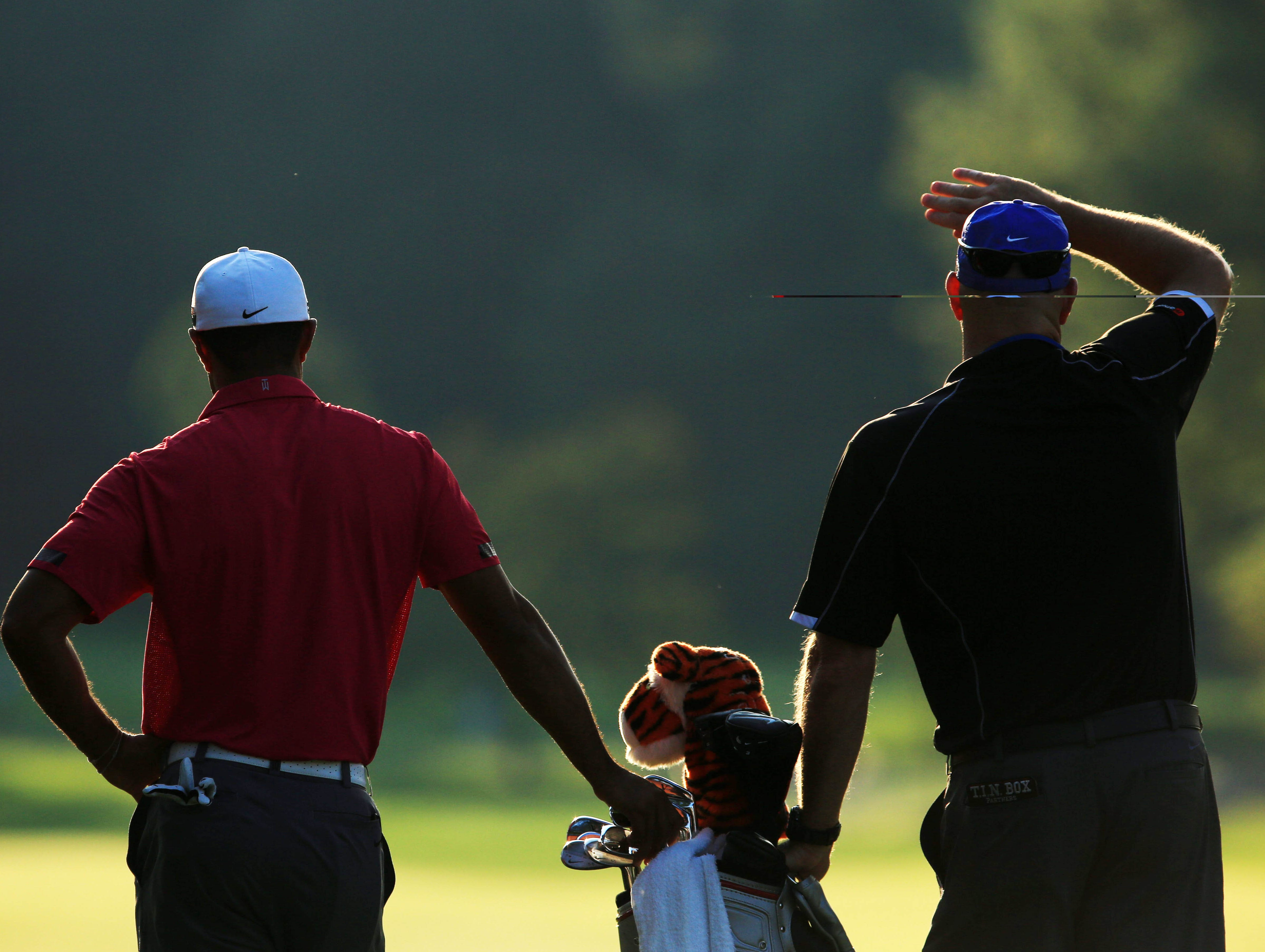 Tiger Woods and his caddie Joe LaCava during the practice round of the 95th PGA Championship at Oak Hill Country Club.