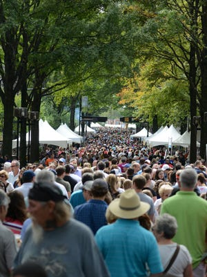 People attend the final day of the food festival Fall for Greenville on Sunday, October 13, 2013.