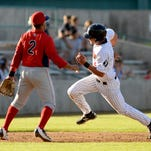 Voyagers' runner Aaron Schnurbusch, pictured rounding third in a game earlier this season, has been named to the Pioneer League All-Star team.