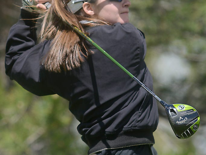Fossil Ridge High School golfer, Katie Laron, tees off during the Front Range League Championships at the Hyland Hills Golf Course in Westminster Wednesday April 30, 2014.
