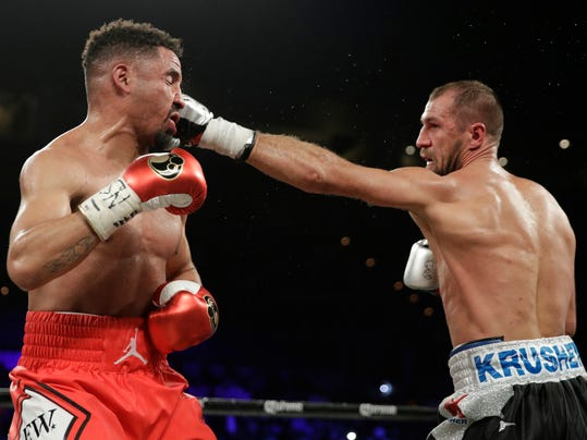 "FILE - In this June 17, 2017, file photo, Sergey Kovalev, right, hits Andre Ward during a light heavyweight championship boxing match in Las Vegas. They call Kovalev ""Krusher."" His opponent Saturday, Nov. 25, 2017, Vyacheslav Shabranskyy, also is a big-time puncher. (AP Photo/John Locher, File)"
