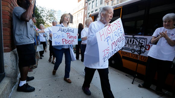 """Nuns on the Bus Cincinnati and other supporters sing """"Joshua fought the battle of Jericho"""" as they march along the sidewalk outside of the  Hamilton County Board of Election meeting on Tuesday."""