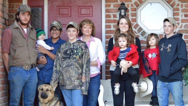 Lou Ann Rieley with several children and grandchildren.
