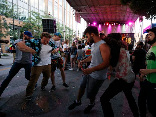Fans mosh in front of the stage as the band Green Death performs Saturday, July 9, 2016, during the second day of the 80/35 music festival in downtown Des Moines.