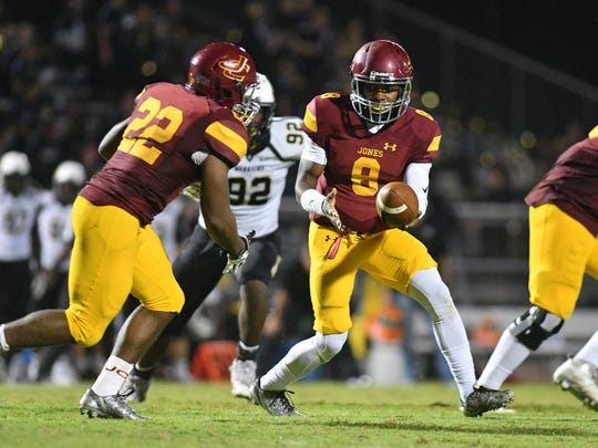 JCJC quarterback Detric Hawthorn (8) gets ready to hand the ball off to Scott Phillips (22) in last week's 49-7 win over East Central.