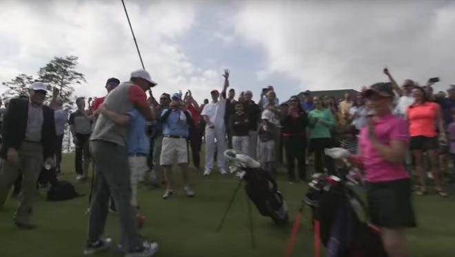 Tiger Woods was all smiles after this 11-year old aced a shot Wednesday.