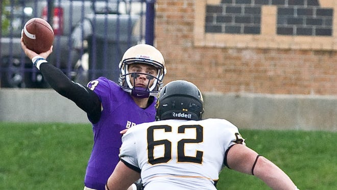 Albion College quarterback Chad Hamilton throws a pass against Adrian on Oct. 1.