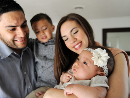 Angel and Karen Garibaldo with son Orlando, 3, and