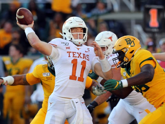 Texas quarterback Sam Ehlinger (11) looks to pass against Baylor in an NCAA college football game Saturday, Nov. 23, 2019, in Waco, Texas. (AP Photo/Richard W. Rodriguez)