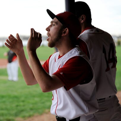Piketon's Andy Helton cheers on his teammates from