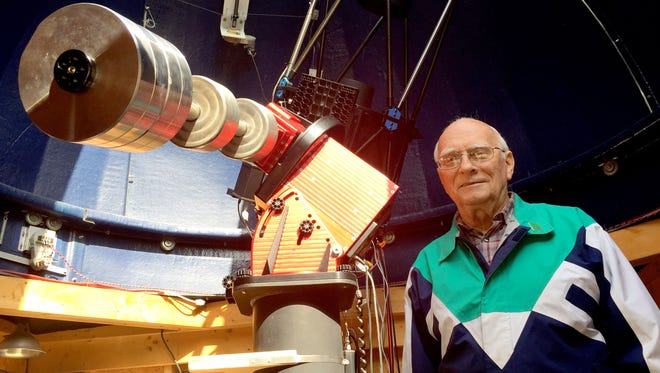 George Korody, 82, of Northville Township next to his large telescope inside the observatory he built in his backyard.