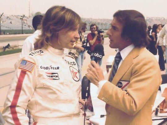 Janet Guthrie is interviewed by Jackie Stewart at Indy in 1978, the second year she qualified for the 500. (AP)
